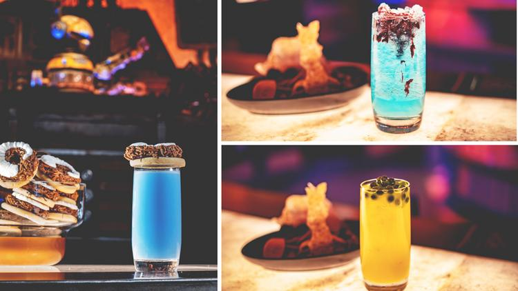"The Blue Bantha also features blue milk and topped with a ""bantha-inspired vanilla-butter sugar cookie."" Other drinks include the Hyperdrive made with Powerade Mountain Berry Blast, white cranberry juice, black cherry purée, and Sprite, as well as the Jabba Juice — a mixture of Simply Orange with pineapple, kiwi, cantaloupe and blueberry popping pearls."