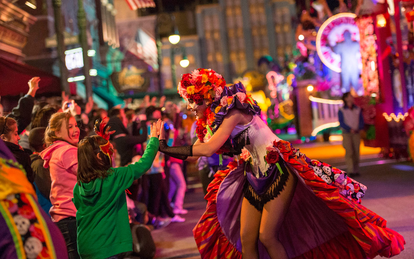 Dance along with masked characters and catch beads during Universal Orlando's Mardi Gras celebration