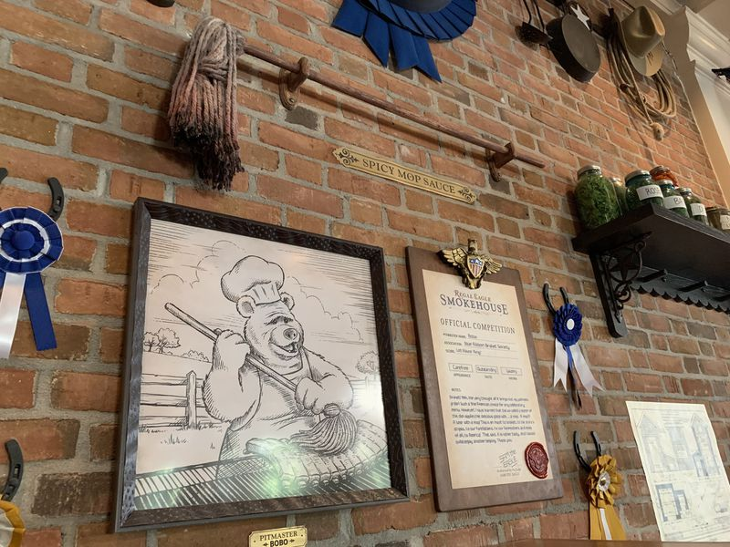 Barbecue competition paraphernalia lines the walls of the new restaurant, including documents sealed by Sam (the?) Eagle.
